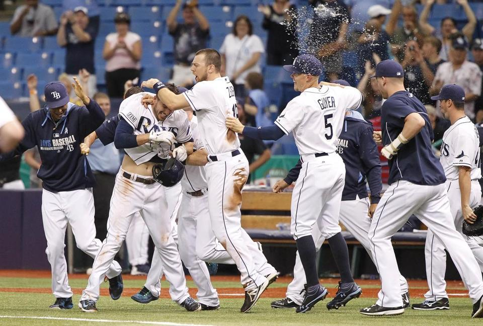 Tampa Bay's Matt Joyce is mobbed by teammates after his walkoff hit beat the Red Sox. Kim Klement-USA TODAY Sports