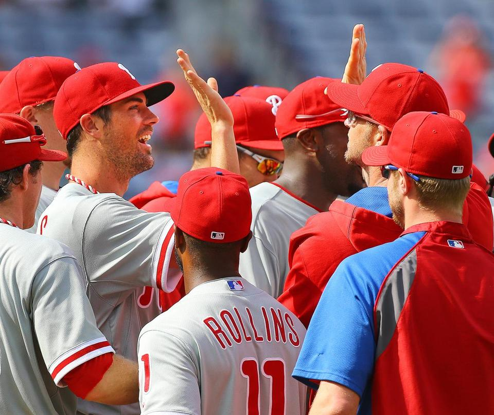 Monday's no-hitter was a team effort, in a game started by Cole Hamels (left). Curtis Compton/AP