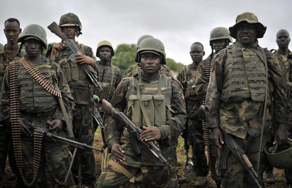 African Union soldiers from Uganda prepared to advance on the town of Kurtunwarey in Somalia Sunday in movements against al-Shabab militants.