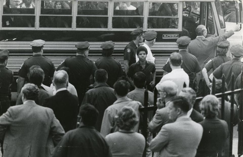 Police officers were deployed to escortablack student arriving at South Boston High School on Sept. 12, 1974, the first day of busing underafederal desegration order.