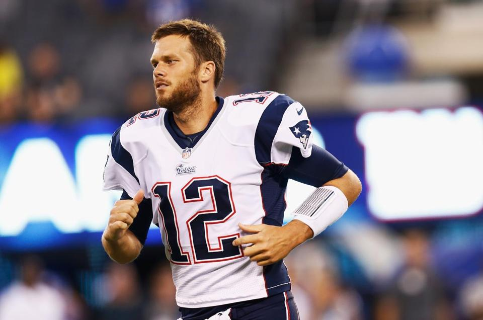 """I haven't really spoken to anybody about it,"" Tom Brady said of the trade that sent his good friend Logan Mankins (70) to Tampa Bay. (Photo by Jeff Zelevansky/Getty Images)"