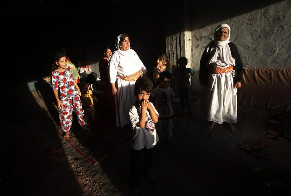 Yazidis displaced by fighting in Sinjar, Iraq, awaited aid last month. Islamic State fighters have killed hundreds.