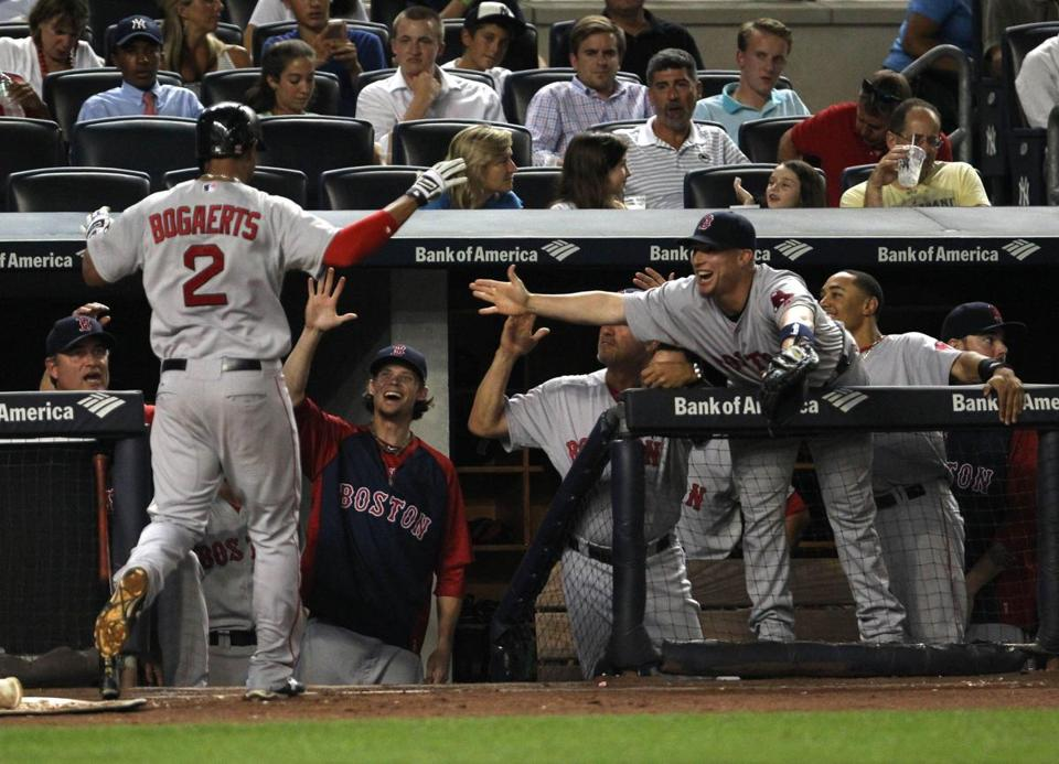 Xander Bogaerts was greeted at the dugout after hitting a home run in the third inning.