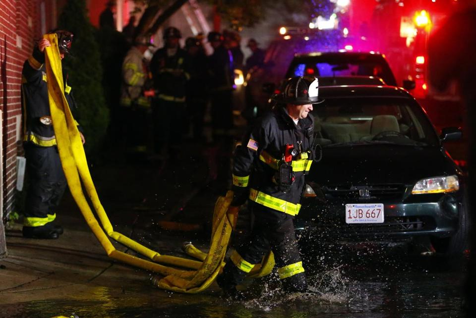 Firefighters cleaned up after a nine-alarm blaze in Allston.