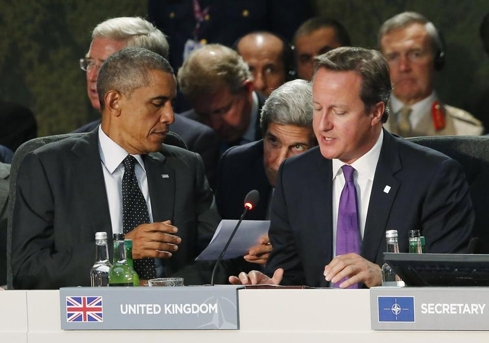 President Obama huddled with Secretary of State John F. Kerry and Britain's prime minister, David Cameron, at the summit.