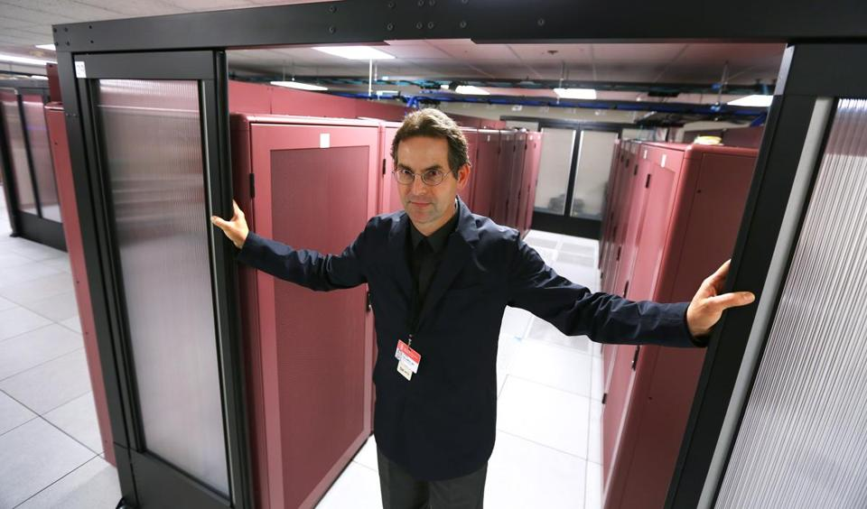 Beth Israel Deaconess Medical Center's Dr. John D. Halamka, shown amid rows of servers in the hospital's data center, is cochair of a federal IT group that advises the government.