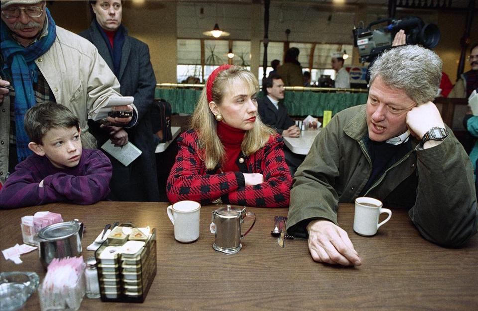 Andrew Dodwell, 9, left, watched as Democratic presidential hopeful Gov. Bill Clinton, of Arkansas, and wife Hillary Rodham Clinton, sipped coffee at Blake's Restaurant in Manchester, N.H., on Feb. 15, 1992.