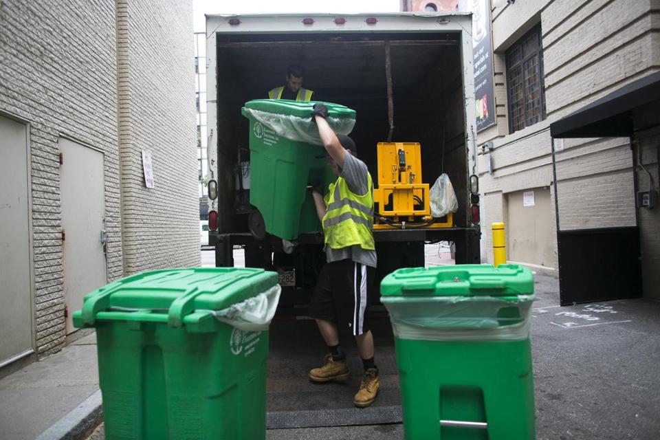 August 10, 2014 Boston, MA - City Table at the Lenox Hotel Nick Settemio, who works for Renewable Waste Solutions, Inc loads organic waste from City Table at the Lenox Hotel (Katherine Taylor for The Boston Globe)
