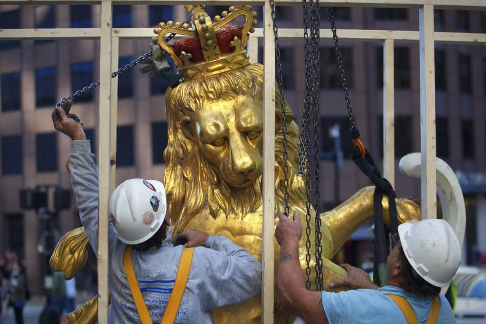 The iconic statues of a lion and a unicorn atop the Old State House on Washington Street in Boston were hoisted down from the rooftop perches last September.