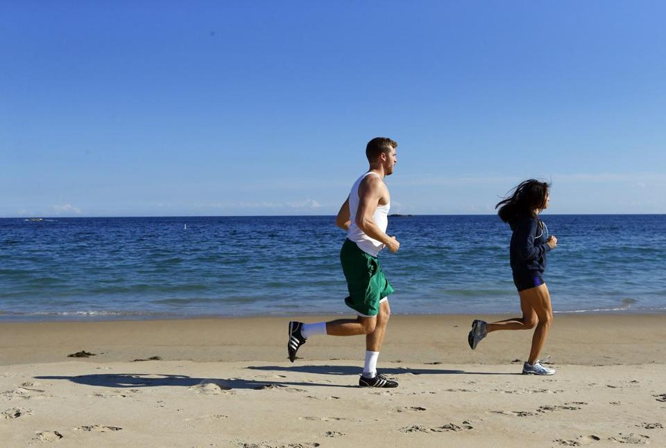 People run along Singing Beach in Manchester-by-the-Sea.