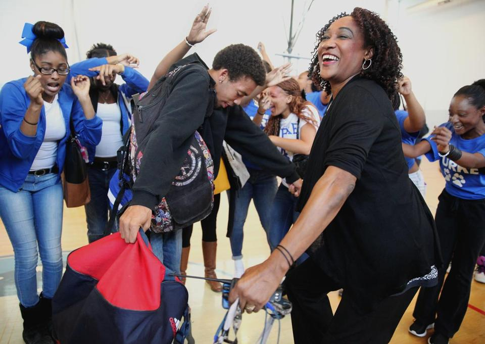 Dacia Evans (far left), Aaron Da Grasa (center), and other students danced with Headmaster Lindsa McIntyre (right) after MCAS scores were released Friday.