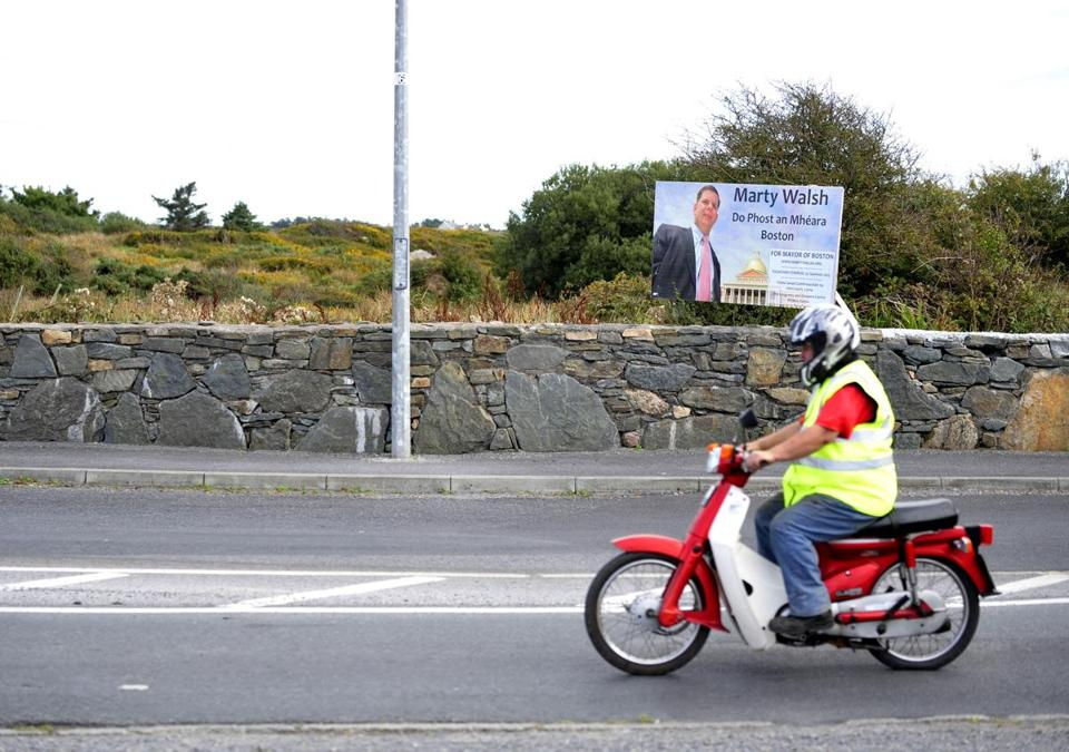 A motorcyclist passed by a poster to Mayor Martin Walsh of in Galway, Ireland.