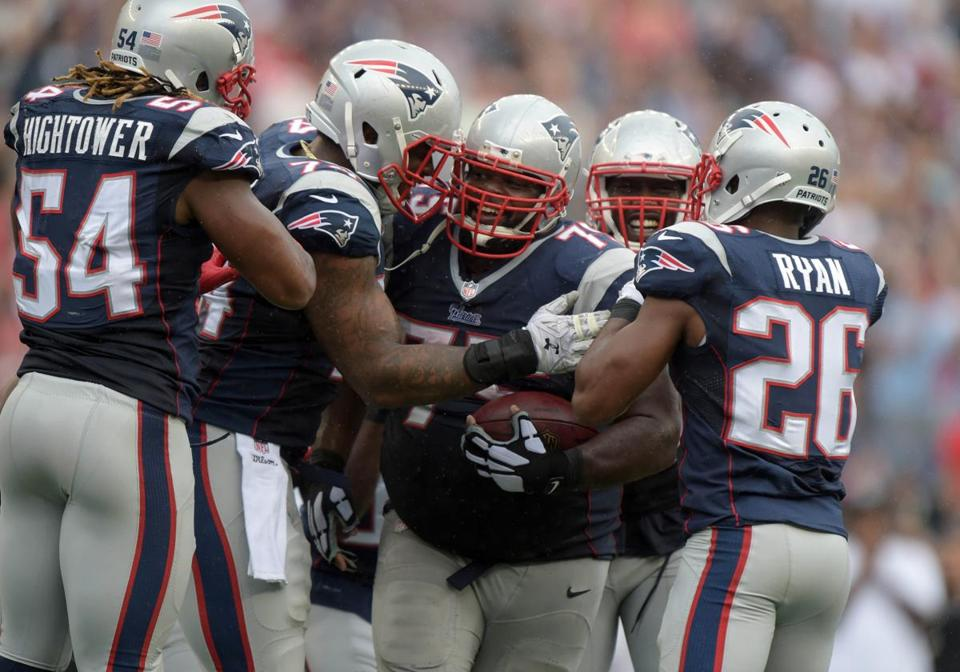 Defensive lineman Vince Wilfork (center) sealed the Patriots' 16-9 victory over the Raiders with an interception in the red zone with 51 seconds left.