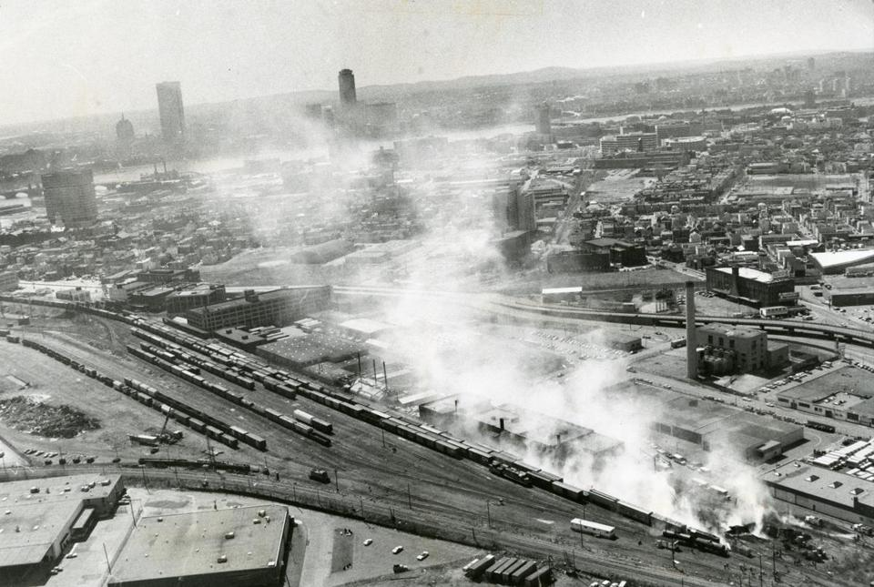 Somerville, MA - 4/3/1980: An aerial view extending to the Charles River of the scene after a tank car heading to the Monsanto Chemical Co. plant in Everett was hit by a diesel locomotive at a Boston & Maine Railroad switching yard in Somerville, Mass. on April 3, 1980. Thousands of gallons of chemical spilled, injuring more than 100 people and forcing officials to order evacuations. (Bob Dean/Globe Staff) --- BGPA Reference: 140630_MJ_040