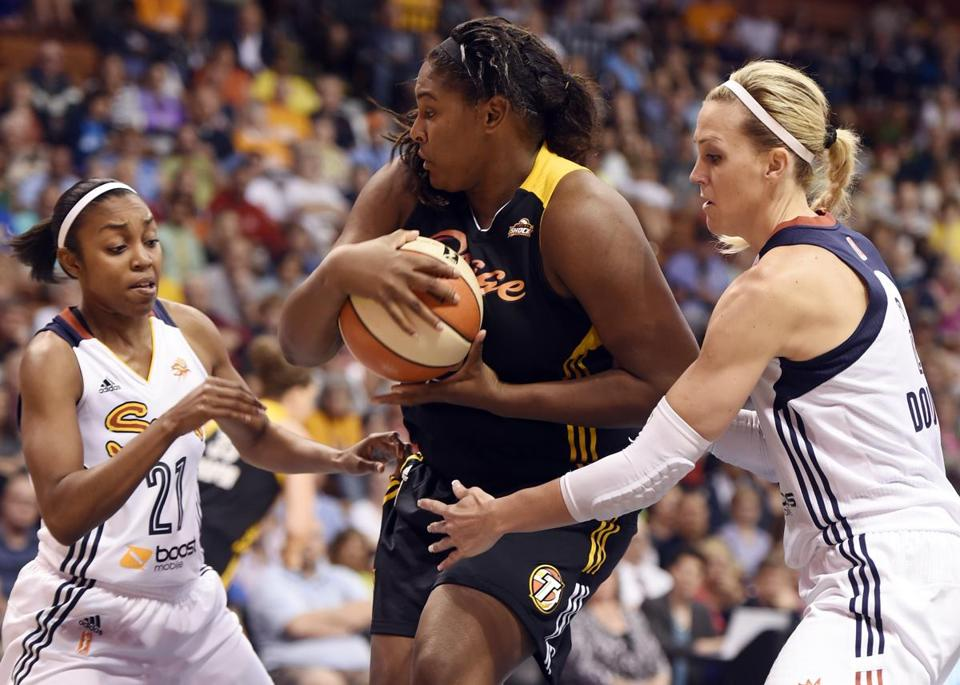Connecticut's Renee Montgomery, left, and Katie Douglas harass Tulsa's Courtney Paris (3) in the second half of a WNBA basketball game, Thursday, July 3, 2014 at Mohegan Sun Arena in Uncasville, Conn. The visiting Shock raced away with a 96-83 win. (AP Photo/The Day, Sean D. Elliot) MANDATORY CREDIT: THE DAY/SEAN D. ELLIOT