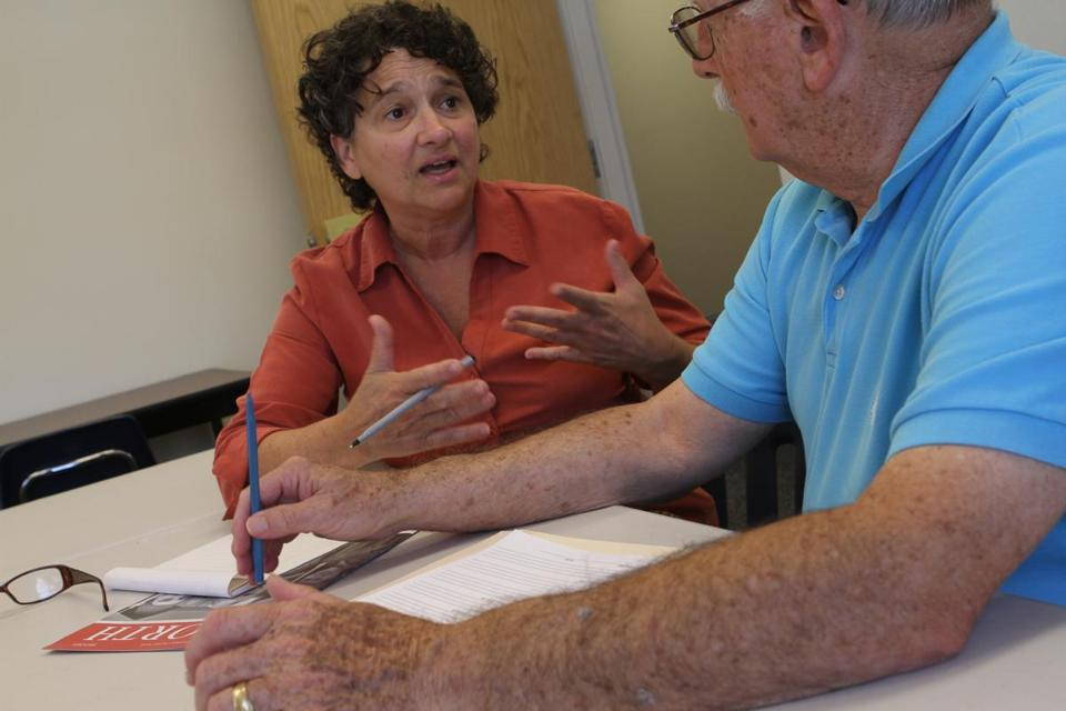 Program coordinator Linda Anderson checks in with  volunteer Jack Kupelnick.