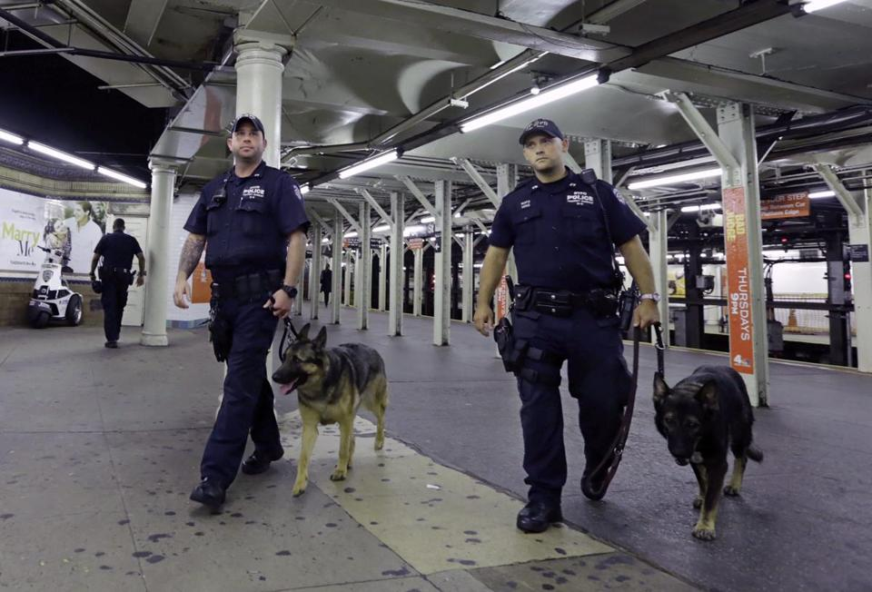 A New York City police canine unit patrolled the subway in Times Square on Thursday. US intelligence officials expressed some skepticism about the possibility of the Islamic State plotting attacks here.
