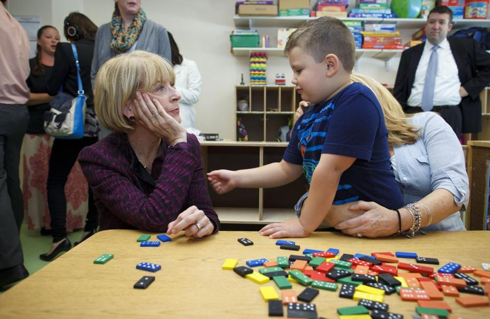 Martha Coakley, a candidate for governor, talked to Cody about toys at a Quincy early childhood education center.