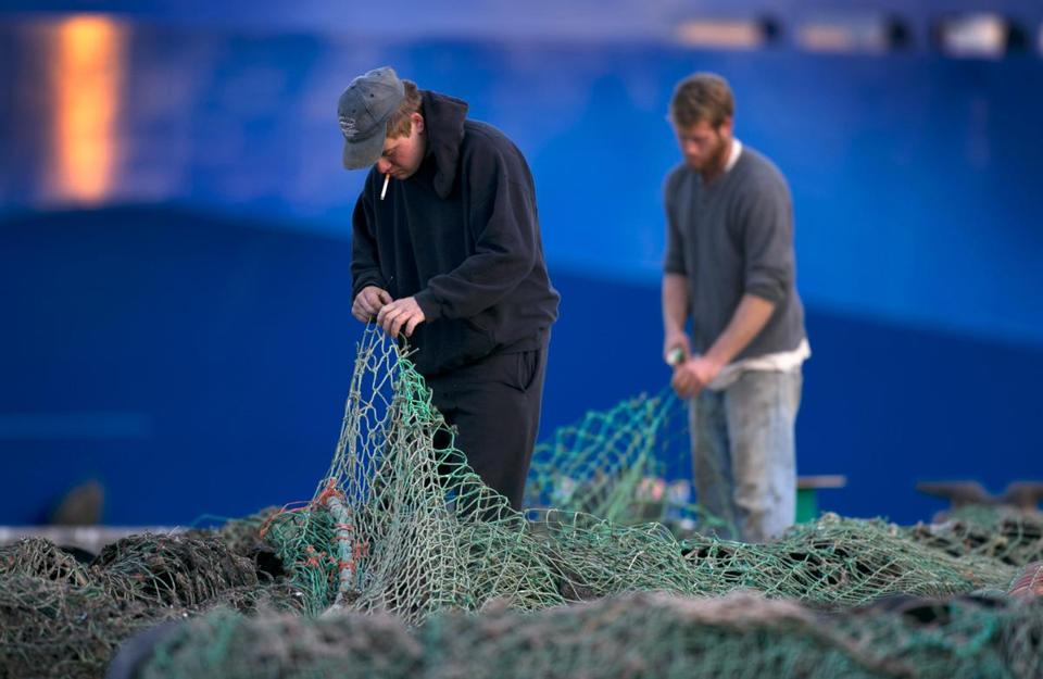 Fishermen mended nets on Merrill Wharf in Portland, Maine, in 2013.