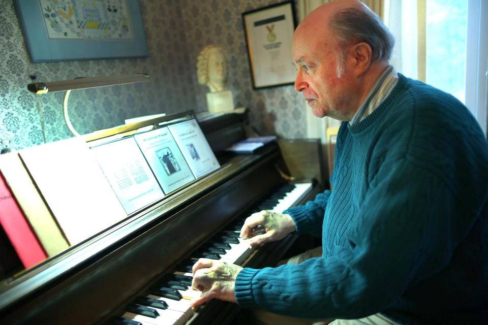 Roger Lee Hall, musician and music historian, at the piano in his Stoughton home.