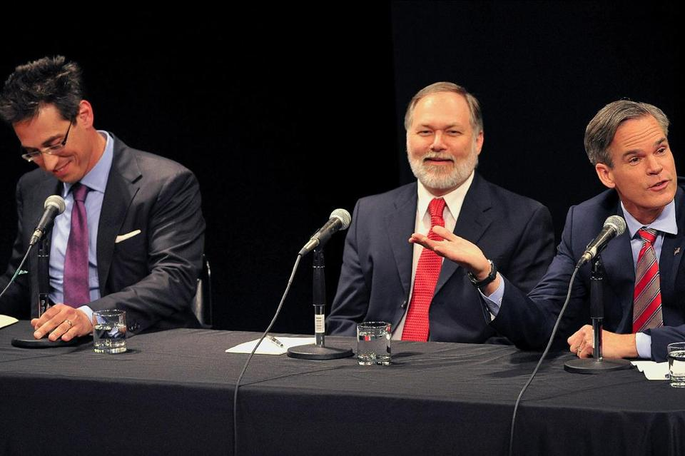 "Scott Lively (center) is a conservative Springfield minister best known for his inflammatory battles against what he calls the LGBT ""agenda."""