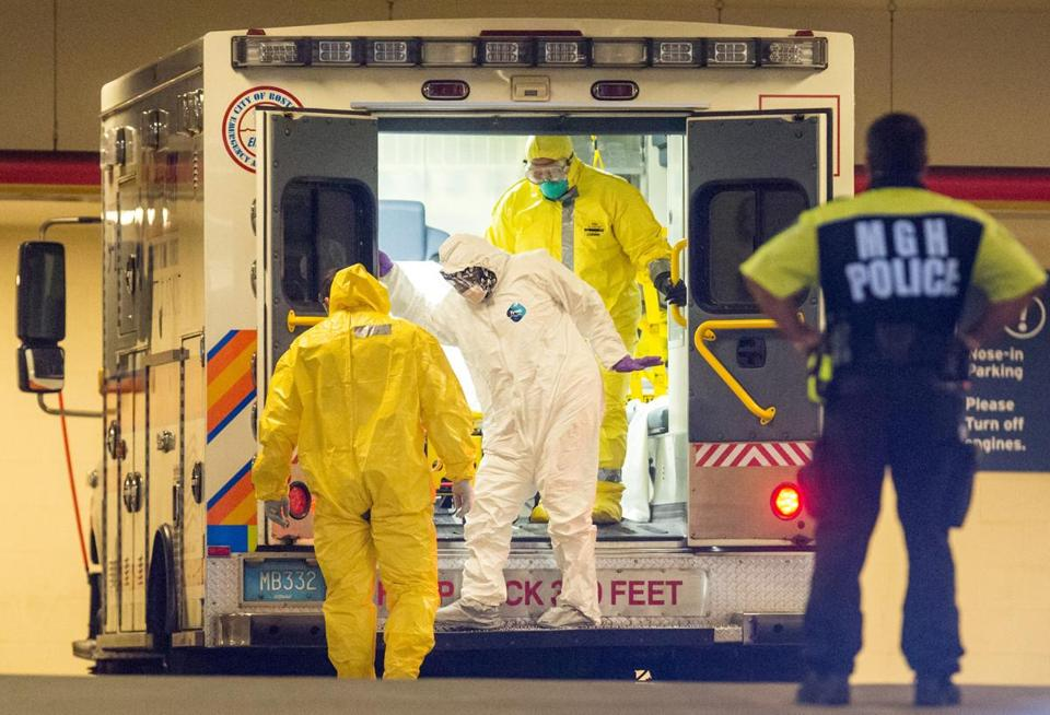 Patients in white hazmat suits arrived at Massachusetts General Hospital. EMS workers wore yellow.