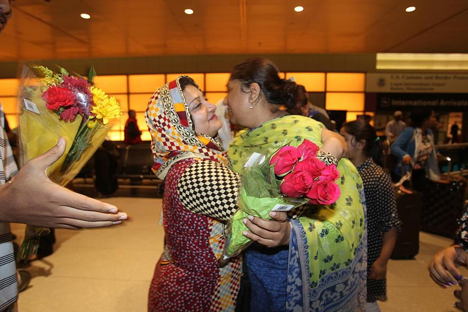 Nusrat Farooq (in scarf) was reunited with relative Saima Alrai, who was on the plane.