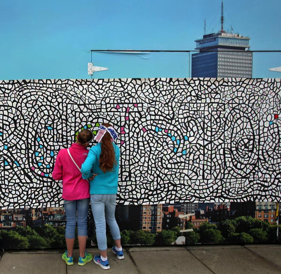 A 60-foot community mural was created outside of the Prudential Center on Memorial Day last year.