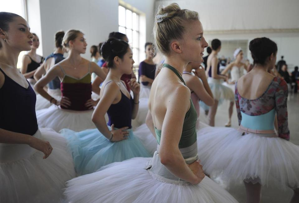 "Shelby Elsbree (front) and other ballerinas await rehearsal for ""Swan Lake."""