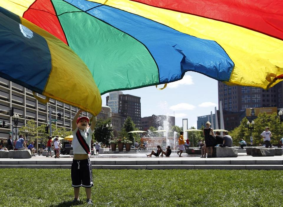 Sam Lottner of New York City played with a rainbow-colored parachute on the Rose Kennedy Greenway in August.