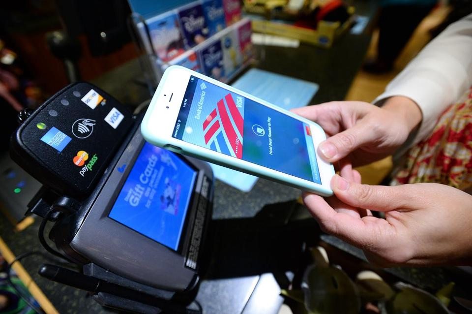 COMMERCIAL IMAGE DISTRIBUTED FOR DISNEY STORE - The magic of Apple Pay comes to Disney Store. A guest makes a purchase at a Disney Store in Glendale, CA using the new Apple Pay technology, which brings an easy, secure and private way to make payments. The new technology rolled out to Disney Store locations nationwide on Monday, October 20, with the launch of Apple's iOS 8.1 software update. (Photo by Jordan Strauss/Invision for Disney Store/AP Images)