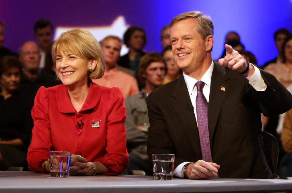 Democrat Martha Coakley, left, and Republican Charlie Baker, right, sparred in a debate in Chicopee Thursday.