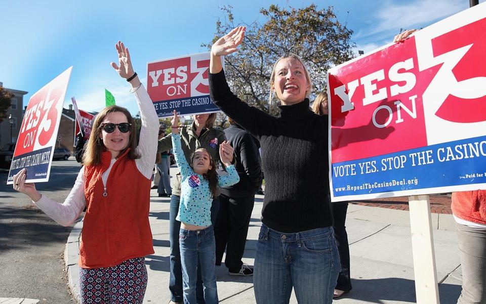 Anticasino advocates waved to motorists in Charlestown on Saturday.