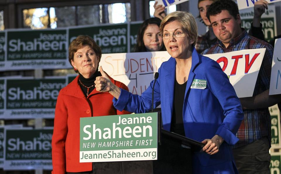 Senator Elizabeth Warren, right, talks about Republican Scott Brown as, left, US Sen. Jeanne Shaheen listens during a campaign event on campus at UNH. Senator Elizabeth Warren campaigned in NH Saturday against Republican Scott Brown on behalf of US Sen. Jeanne Shaheen.