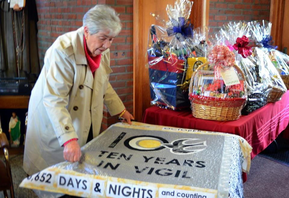Parishioner Pat McCarthy put an anniversary quilt on a table.