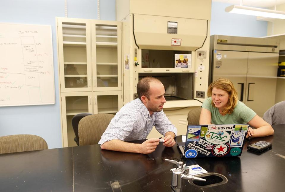 Andrew Kemp (left) analyzed data from foram samples with Tufts senior Elizabeth Webber-Bruya, 21.