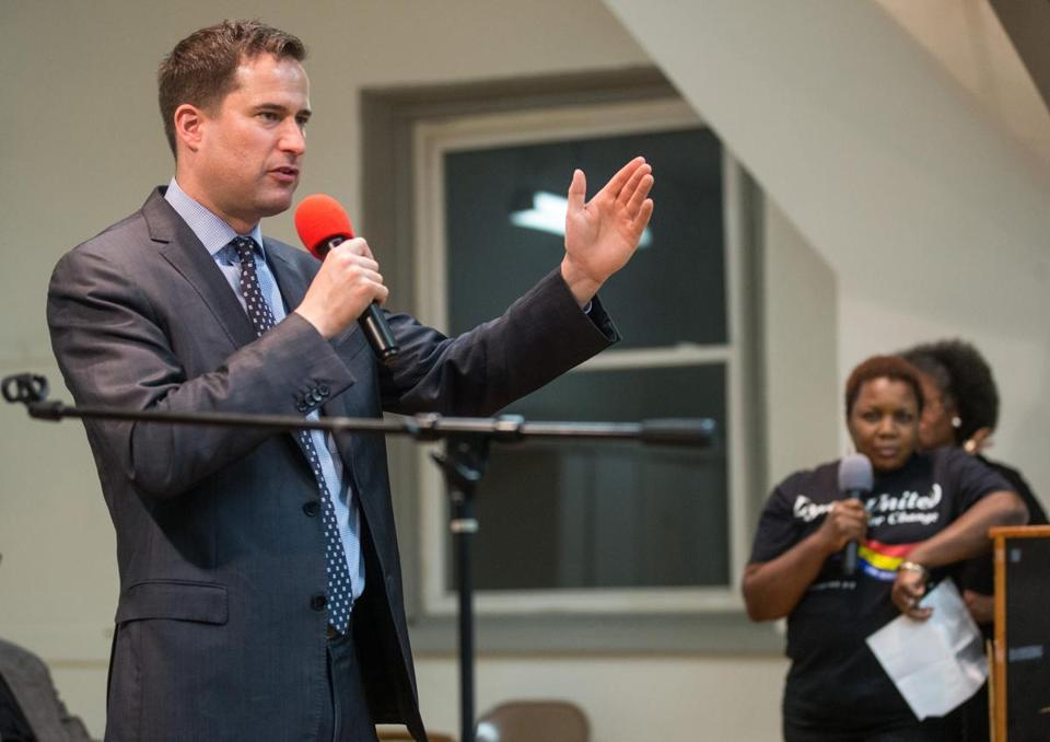 Democratic candidate Seth Moulton answered a question from Louise Fortune (right) at St. Stephen's Episcopal Church in Lynn.