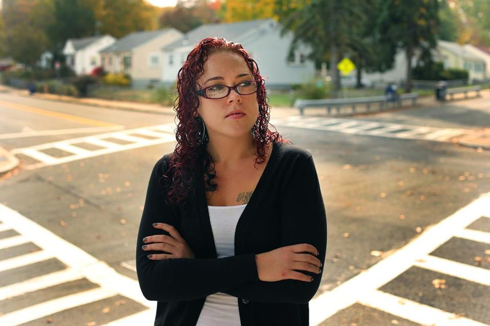 Briana O'Neill stood at the Hyde Park intersection where her car (below) was hit by a vehicle driven by Officer Richard Jeanetti. John Tlumacki/Globe Staff