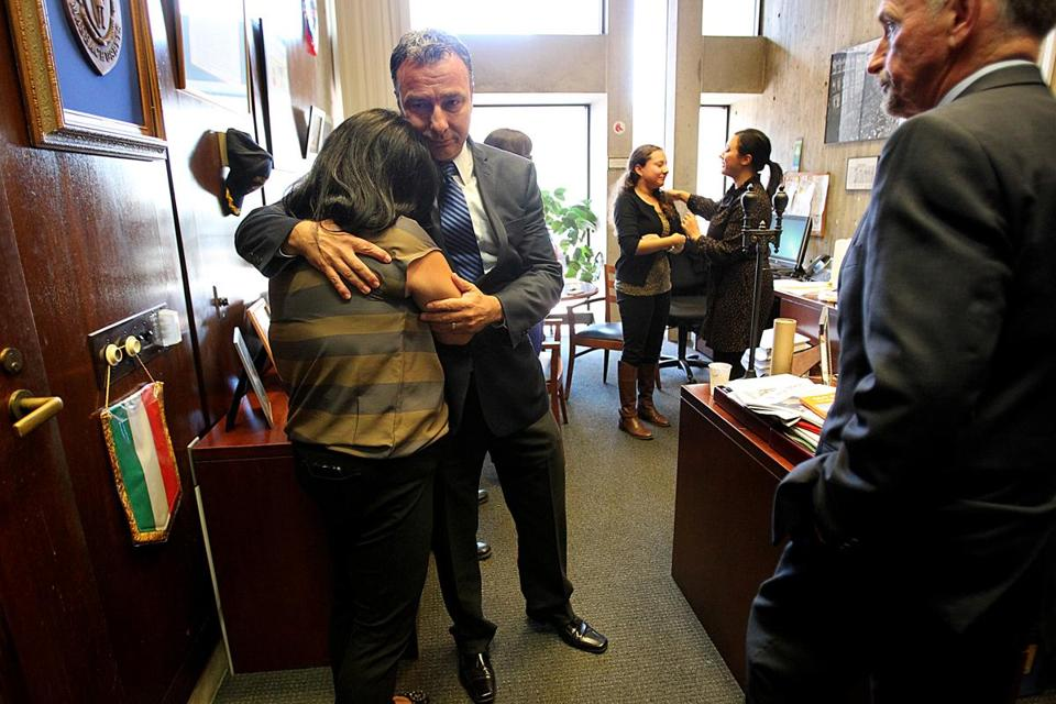 Boston City Councilor Sal LaMattina hugged City Hall employee Nicole Leo in the council offices as City Council President Bill Linehan looked on.