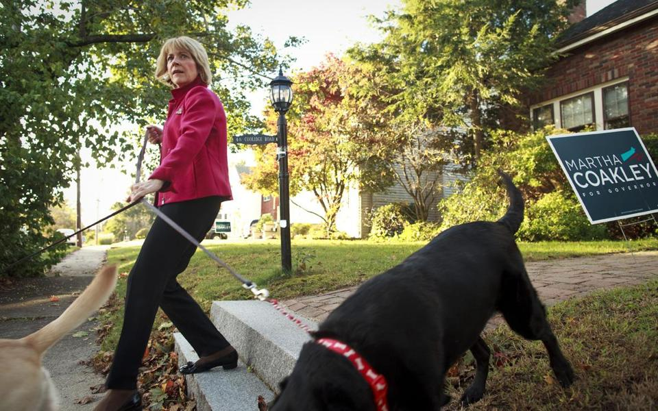 Democratic candidate for Governor Martha Coakley took her dogs for a quick walk before leaving her home early Saturday morning on Oct.25, for a full day of campaigning.