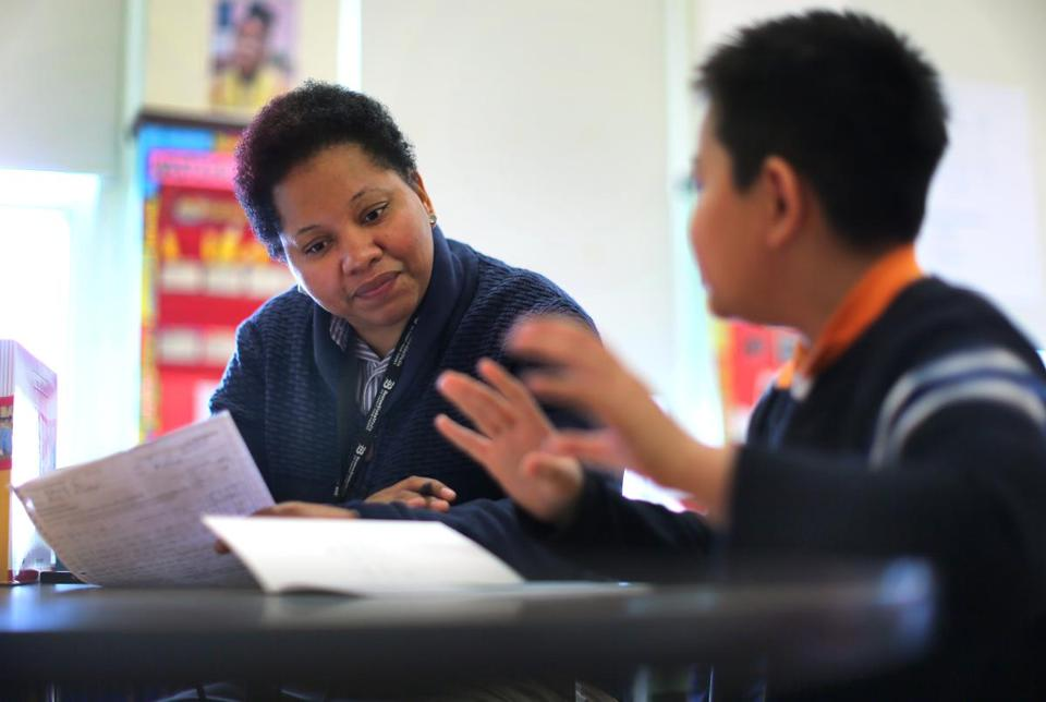 At Boston's Mather Elementary School, fourth-grade teacher Tamika Fluker has to spend a lot of time administering tests to students in her class, which many say takes away valuable teaching time.