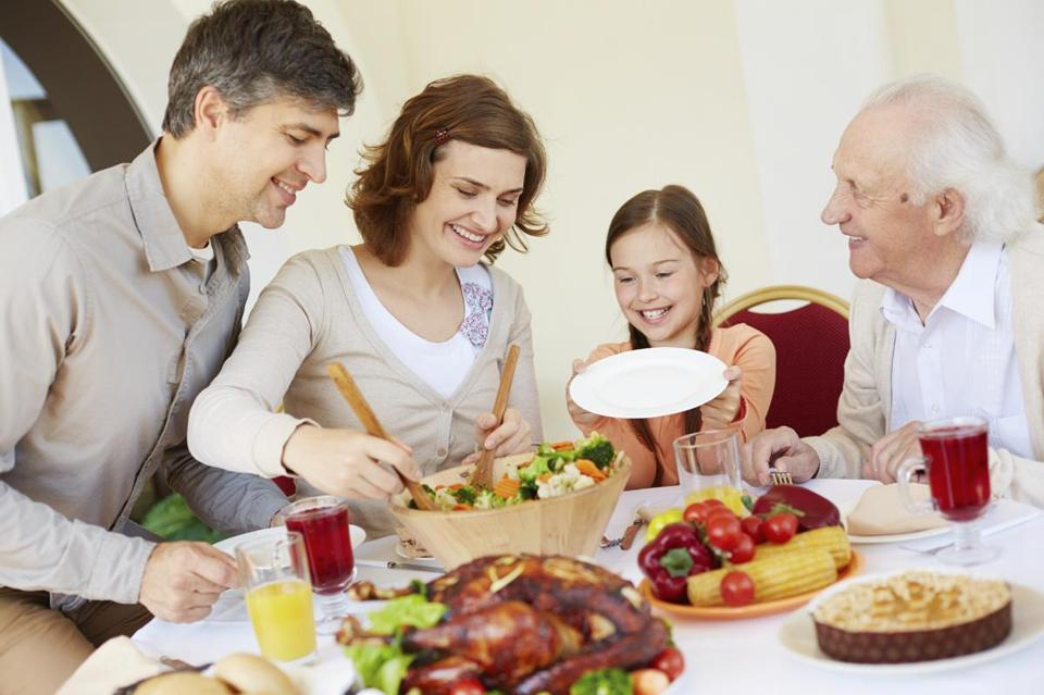 Portrait of affectionate family by Thanksgiving table