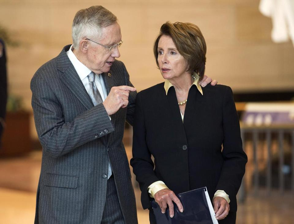 Senate Majority Leader Harry Reid speaks with House Minority Leader Nancy Pelosi in Washington last month.