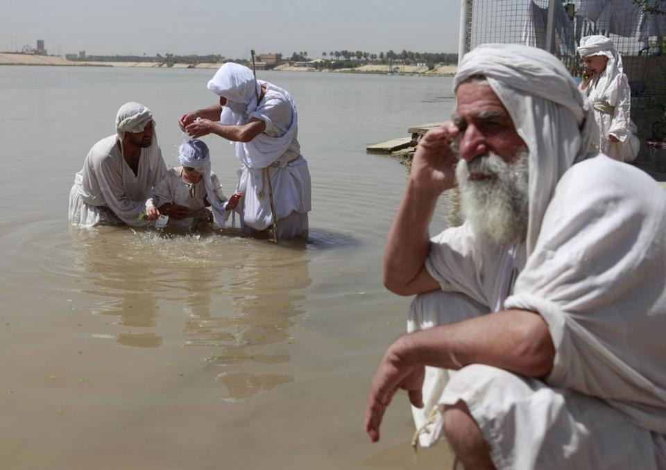 Members of the Sabean Mandaeans take part in a bathing ritual on the Tigris River in Baghdad.