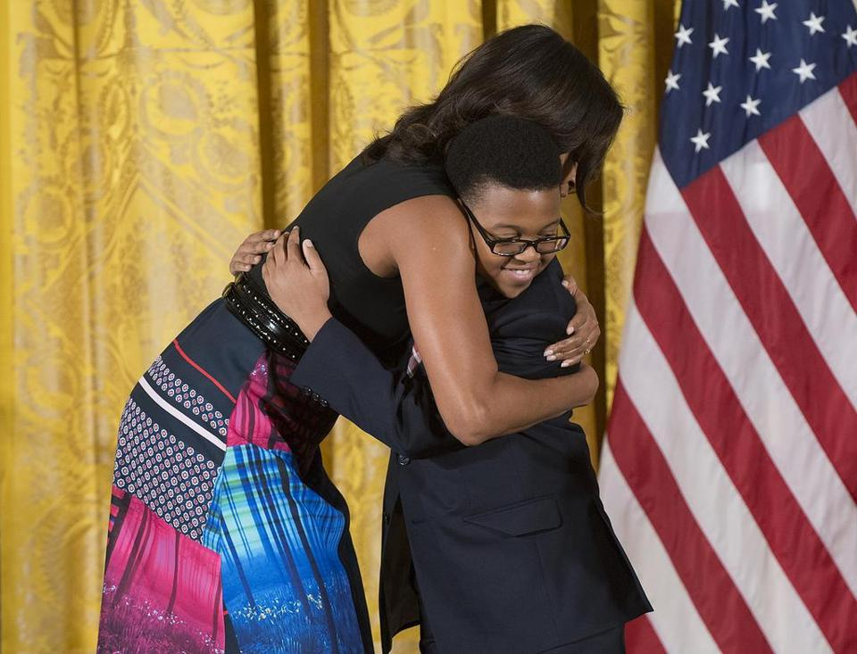First Lady Michelle Obama hugged Ajani Boyd of Dorchester, a Project STEP student, at the White House.