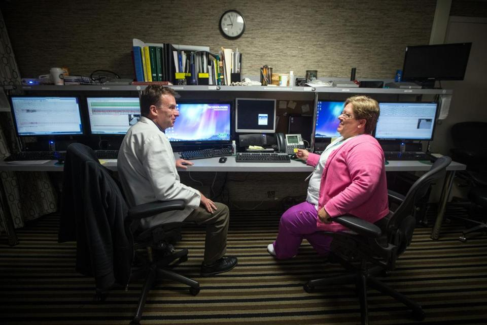 Sleep technicians Kevin Kane and Cheryl Crowley monitor patients at the MGH Sleep Center in Boston.