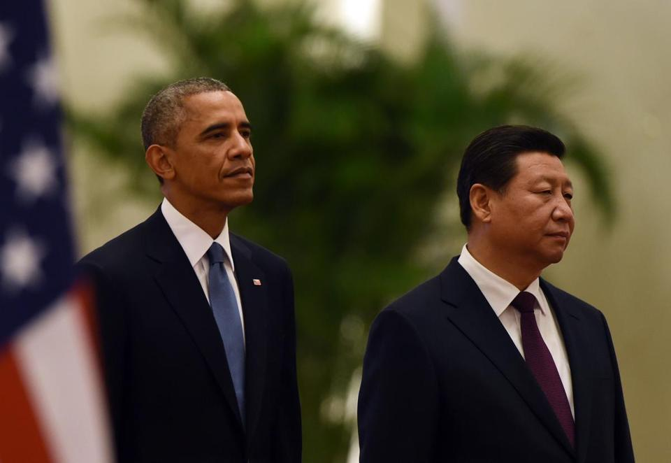 President Barack Obama with Chinese President Xi Jinping as they listened to the Chinese national anthem during a welcome ceremony in the Great Hall of the People in Beijing on Nov. 12.