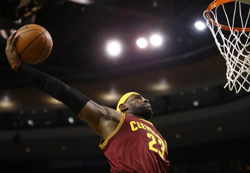 LeBron James slams home 2 of his 41 points on Friday night at TD Garden.