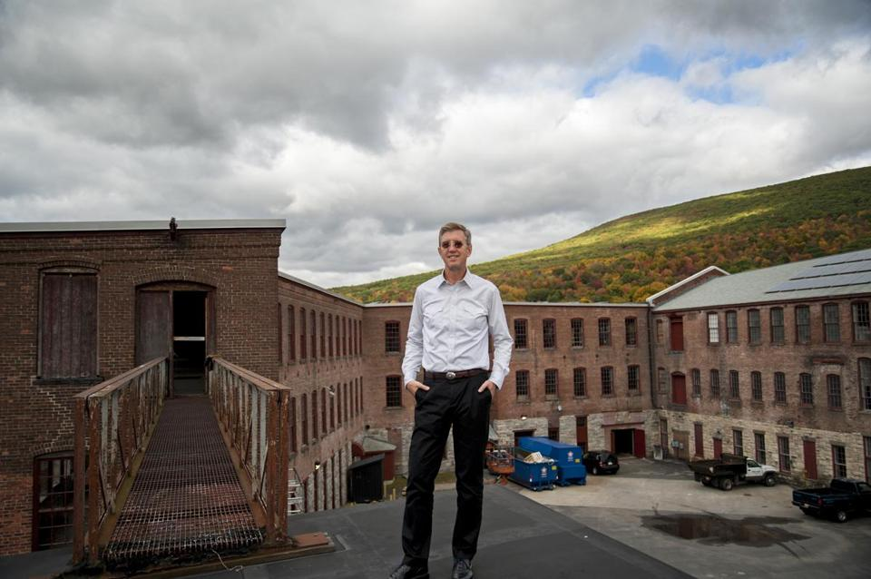 Joe Thompson, founding director of Massachusetts Museum of Contemporary Art, stood in front of the soon-to-be-restored Building 6 on the North Adams campus.