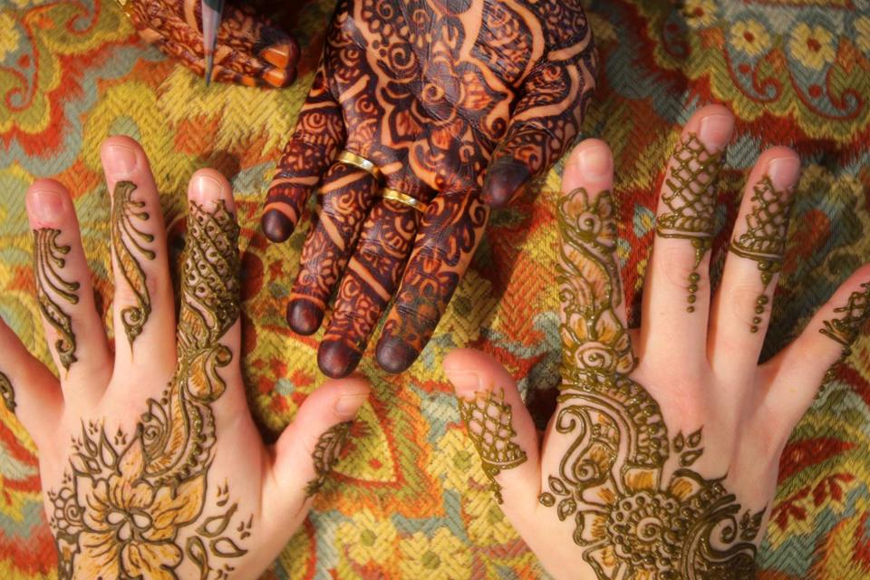 Noureen Sultana's hand adorned with finished henna.